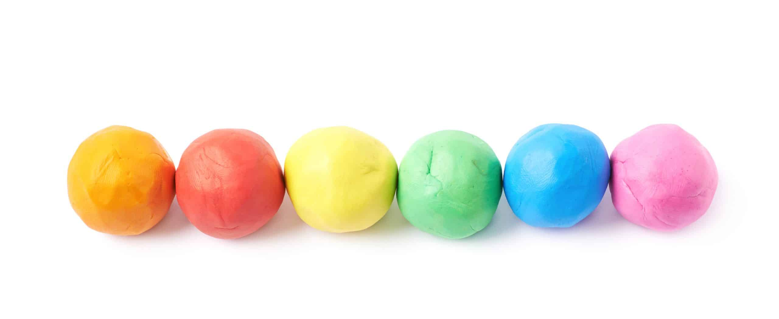 Lined up plasticine balls isolated